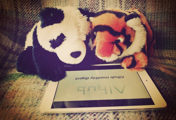 Panda and tiger reading