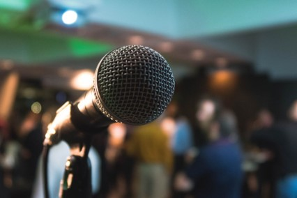 microphone in front of a crowd
