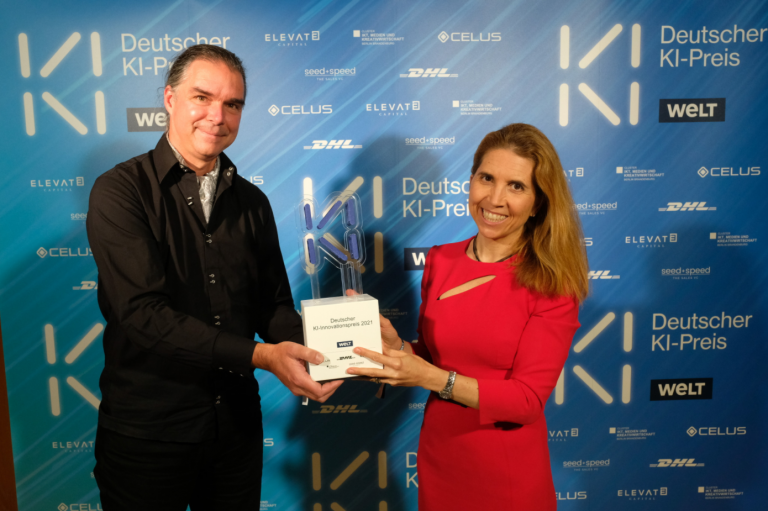 Holger Hoos and Nuria Oliver receive the Innovation Award