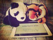 Panda and tiger reading